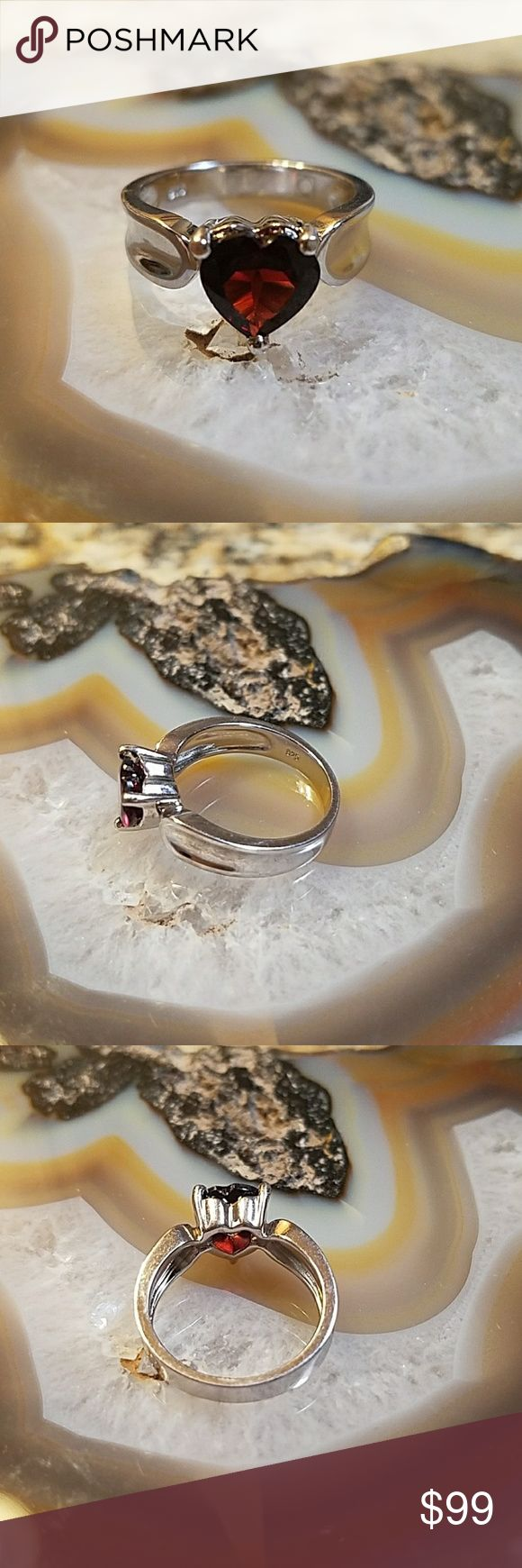 Garnet ring, 18wgp/Sterling ring 18k white gold plated over sterling garnet ring,  size 7  ~~weight 4.4 grams  ~~2.5 carats genuine garnet  ~~beautiful,  well made  ~~stamp .925 in several pic, Maker circle in box pictured  ~~boutique item, comes in plain box  Offers welcome  ♡♡Or add to a bundle for a private no obligation offer from me via dressing room  ☆Non smokers tho we do have pets so a stray hair might transfer.  Items are stored away from pets. Jewelry Rings