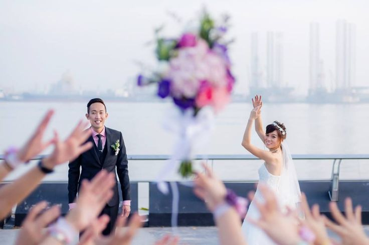 Wedding day photography in Singapore at Woodlands Waterfront Park! - Bouquet toss!