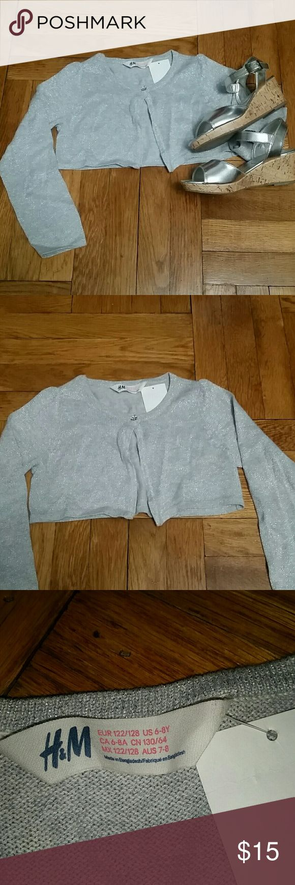 H&M Silver Cardigan (NWT) H&M Long sleeve Silver Cardigan with one jeweled button as closure. NEW WITH TAG! Size 6-8Y H&M Shirts & Tops