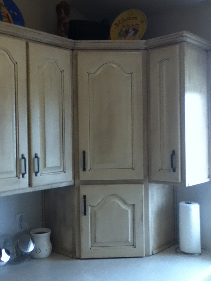 Painted and glazed all of the kitchen cabinets Divine White with Van Dyke Brown glaze
