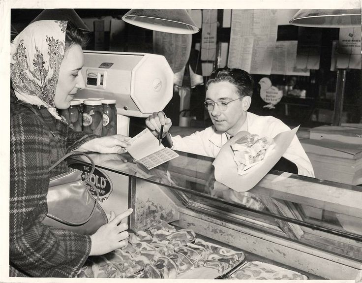 In 1943 this woman from Chicago is using her ration books to buy pork chops at the butcher shop! #butcher #meat #ration