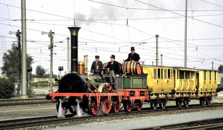 Der Adler mit dem Zug, wie er den Beginn der Bahnzeit in ...