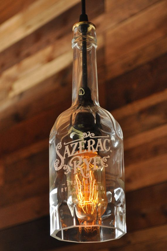 This is a Sazerac Rye bottle that I cut and wired into a hanging pendant lamp. The painted lettering on the bottle really adds that old time look
