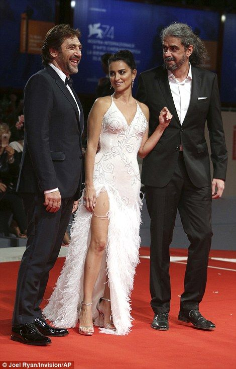 Picture perfect: The couple posed for photos with the film's director Fernando Leon de Aranoa on the red carpet
