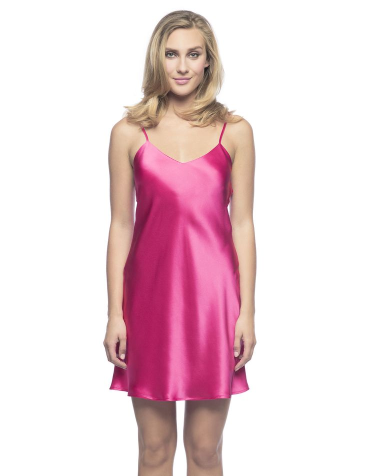 $180 Corazon Slip Du Jour in Fuschia.  Beach-to-Bar slip!  Living-wear at its best bias-cut silk slip, practically lined front and back neckline featuring golden adjustable spaghetti straps ideal to sparkle under the sun.