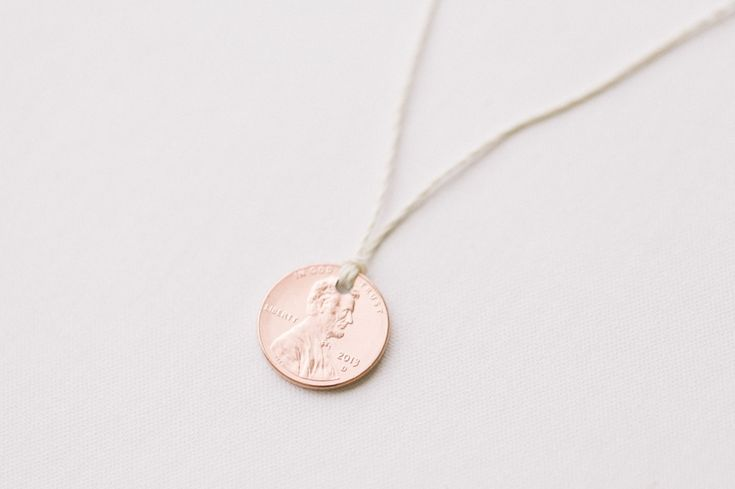 It's Lucky Penny Day tomorrow - we made these lucky penny necklaces to get ready!