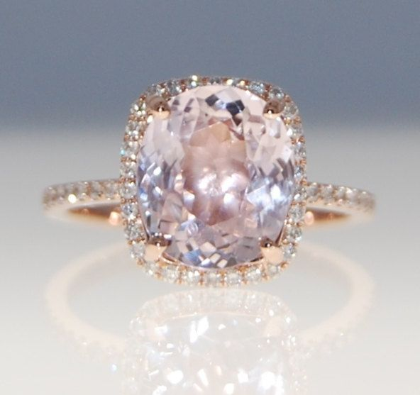 3.2ct peach champagne sapphire ring. I totally love this!