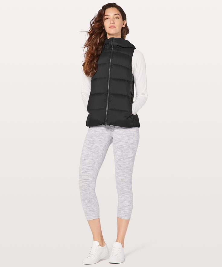 Black size 2 or 4  Weightless Wunder Vest - This puffy vest is  lightweight, warm, and offers  wind and water protection,  making it a no-brainer for  unpredictable weather.
