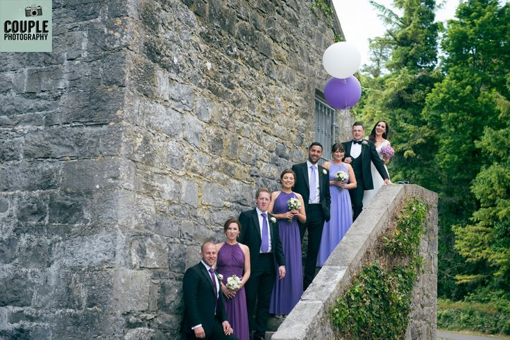 The bridal party showing of the shades of purple and matching balloons! Weddings at The Radisson Galway photographed by Couple Photography.