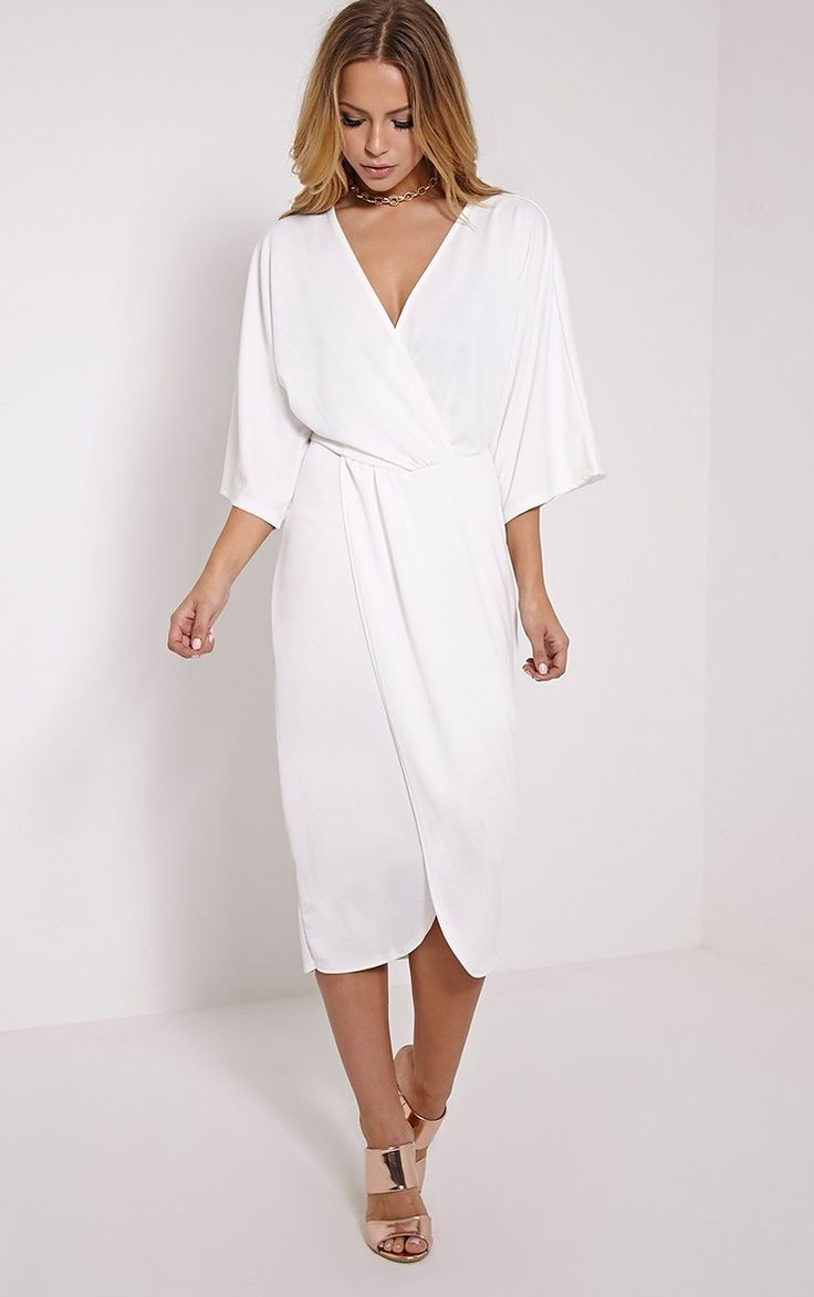 Cream Cape Midi Dress Featuring elegant midi length and a contemporary wrap design, this sleek d...