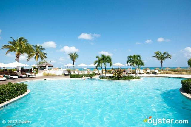 Main swimming pool at The Sands at Grace Bay overlooks Grace Bay Beach in Turks & Caicos
