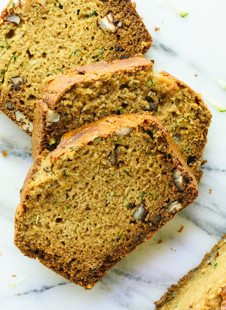 Fluffy and moist zucchini bread, made healthier with whole grains, natural sweetener (honey or maple syrup), and coconut oil instead of butter. cookieandkate.com