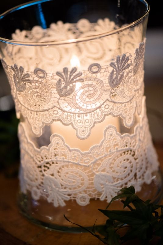 gorgeous lace jars reception decorations    Do these upside down with fake candle and glue wood cake plate on top for mini cake stands as centre piece