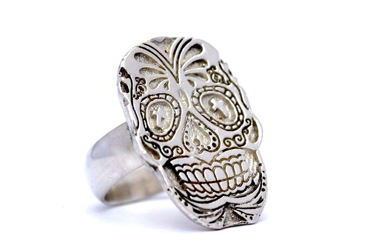Handmade from sterling silver this skull ring is inspired by the Mexican Day of the Dead festival Dias de los Muertos. In Mexico, sugar skulls are decorative skulls made from sugar and painted in bright colors as offerings to honor the deceased. This ring is designed to be worn to remind us that life is a precious gift and that we must live each day as if it were our last. Designed by  Kate McCoy Jewellery.