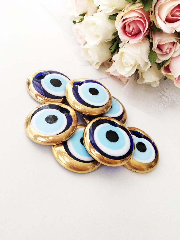 A personal favourite from my Etsy shop https://www.etsy.com/listing/478500096/10-pcs-evil-eye-charm-gold-unique