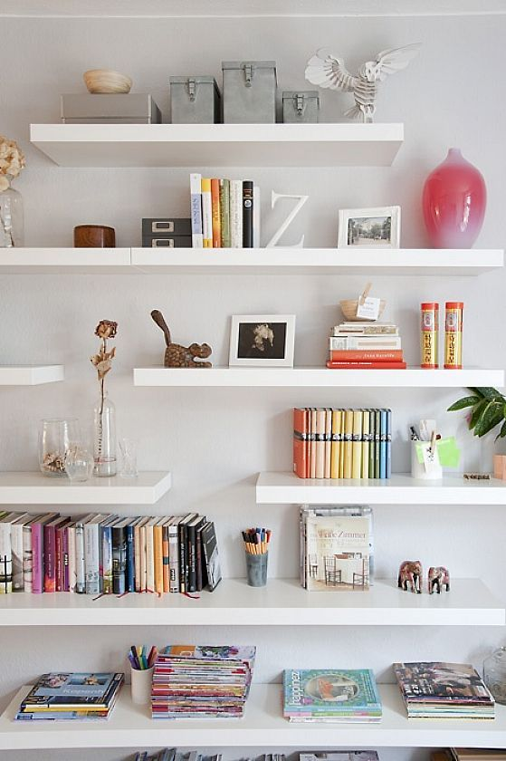 Ikea LACK shelving.  I love the staggered shelves here.  Thinking maybe put the fabric bins in the closet after all, shake up the shelving in the room like this and put craft supplies in nifty containers there instead.