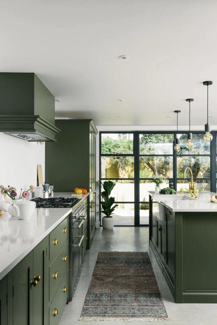 green kitchen inspiration for modern updates purewow in 2020 green kitchen interior devol on kitchen interior green id=22893