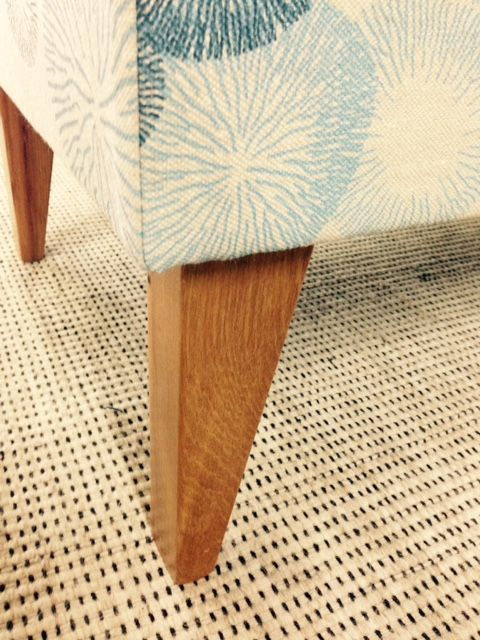 Recycled rimu legs on our classic ottoman