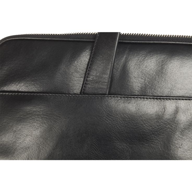 """""""Silkeborg"""" has a classic design which features two rounded leather handles and zip closure. Just the essentials."""
