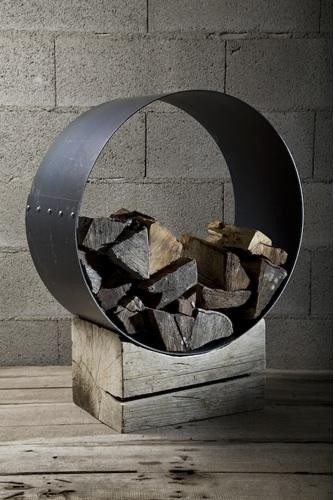 wood storage would need to be huge, circles are just so...serene and sculptural.  Outside!
