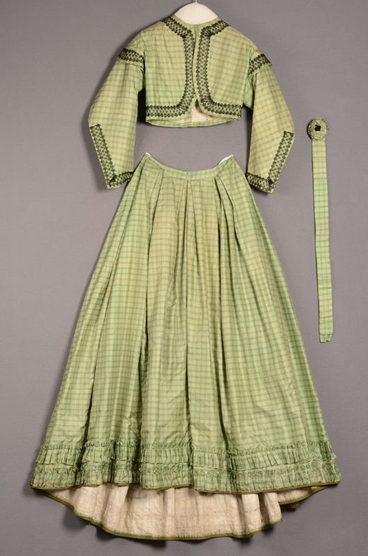 Ensemble consisting of skirt, bolero jacket, and belt, ca. 1862-64. Checkered green silk trimmed with black lace.