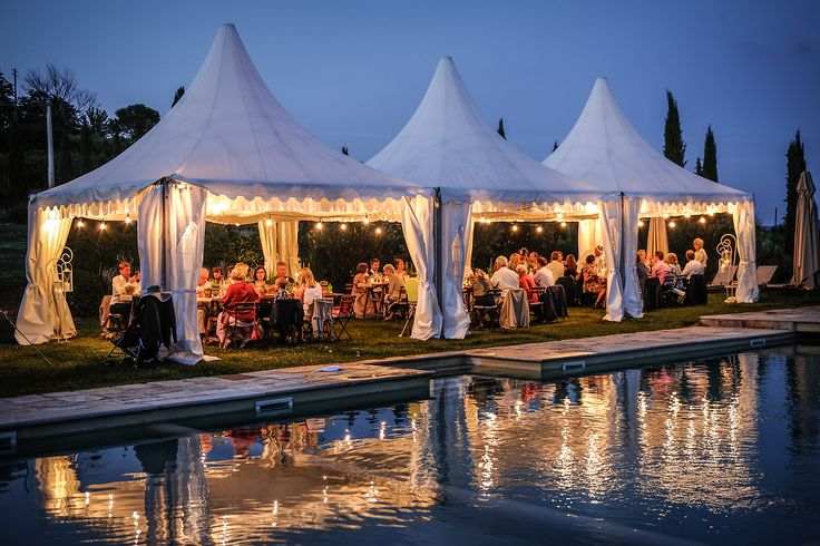 Dinner set up under marquee along the pool area in the chiantishire