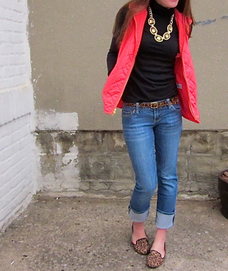 Red puffer vest / jeans / leopard-print belt and shoes                                                                                                                                                                                 More