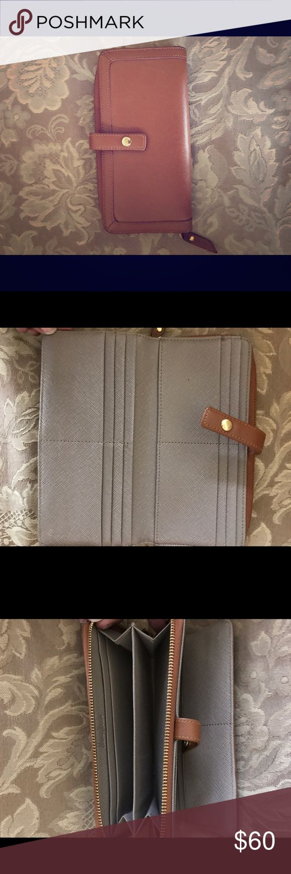Neiman Marcus All in one clutch/wallet Neiman Marcus all In one clutch/wallet in great condition 12 credit card slot, cash and coin side with zipper closure. Neiman Marcus Bags Wallets