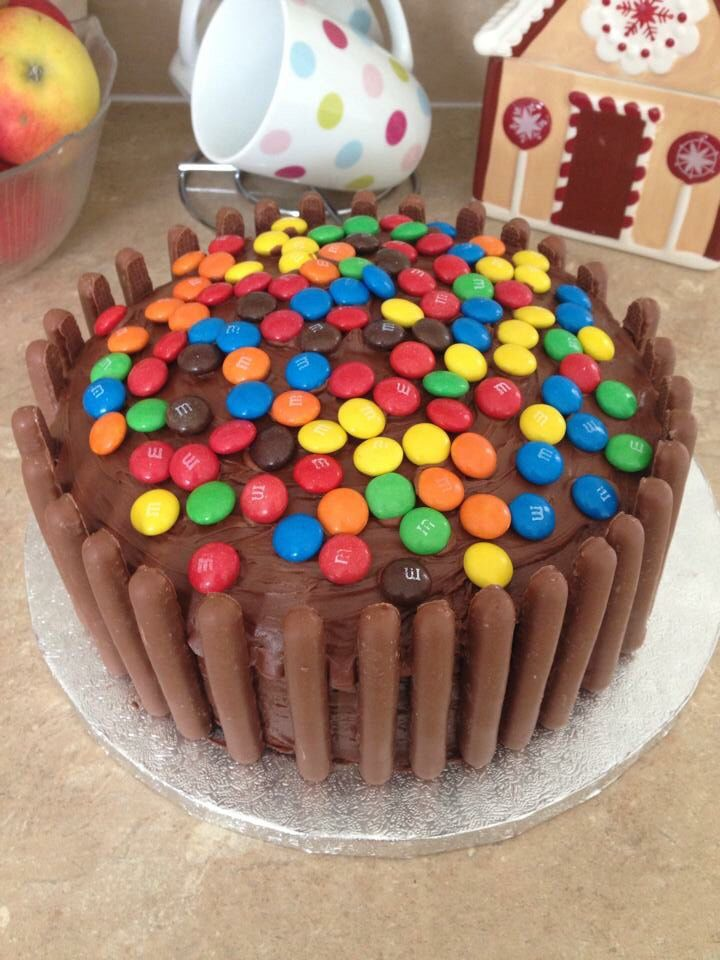 Chocolate swirl cake filled with a light chocolate butter cream. Decorated with chocolate sweets.