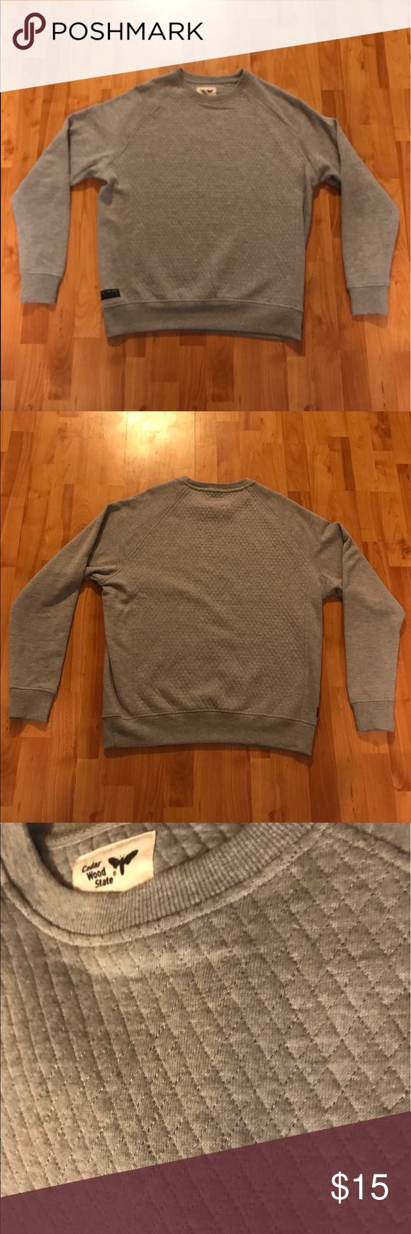 Cedar Wood State Large Gray Crew-Cut Sweatshirt Cedar Wood State is the brand. It's a Gray crew-cut sweatshirt. Crew-cut is the normal neck line. It's a Large but does run a little smaller than most Large sweatshirts. On the torso, it features a diamond stitched pattern (photo3). **willing to bundle or negotiate, but we're looking for close to asking price. Thank you and please share this listing 💁🏻👨🏻❤️ Cedar Wood State Shirts Sweatshirts & Hoodies