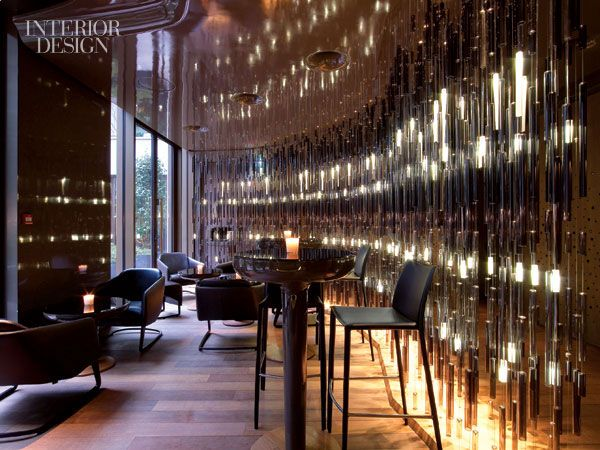 Custom led pendant fixtures in venetian glass form a curtain in the bar mandarin oriental