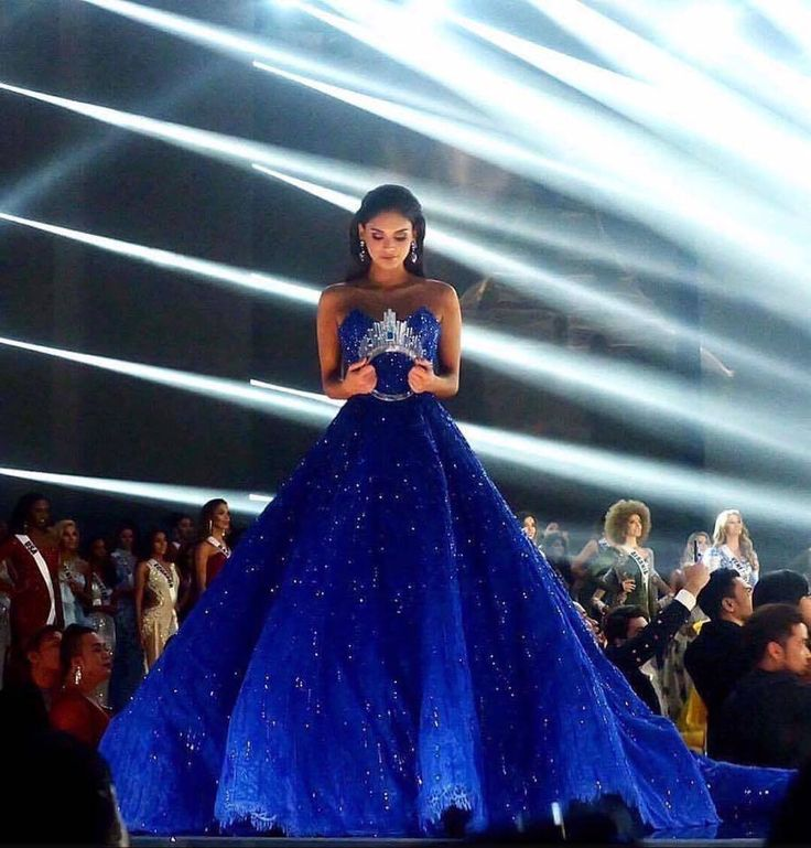 Outgoing Miss Universe Pia Wurtzbach Official with the crown, dressed in a couture blue gown by Michael Cinco.