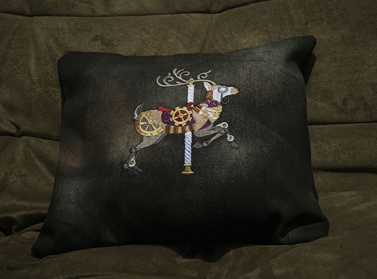 A beautiful black denim pillow case with an embroidery. Fab!
