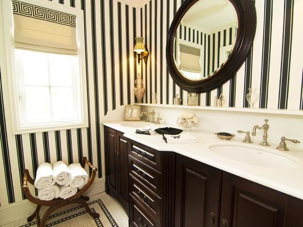 Traditional Bathrooms.  Honed marble is used on the countertops, while thee Farrow and Ball striped wallpaper and the Schumacher Greek Key fabric for the Roman shade creates a timeless style.
