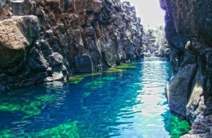 "A visit to ""Las Grietas"" on Santa Cruz Island.  Directly translated, ""grieta"" means crevasse or crack.  Las Grietas is a place to swim in cool ocean water between two tall cliffs, where the earth has opened like a ""crack"" or ""crevasse""."