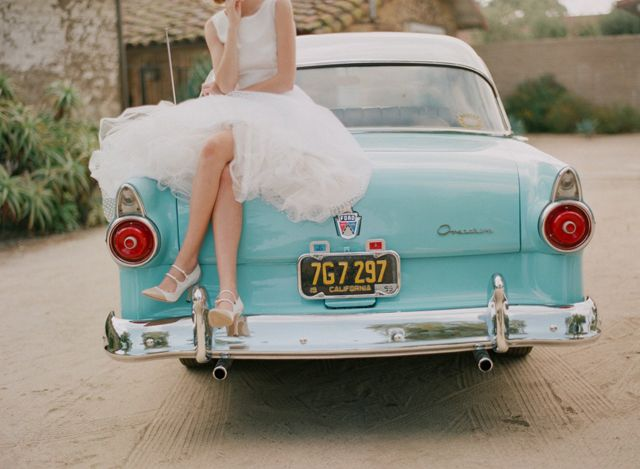 Love this photo, great way to bring  your wedding transport into your photography