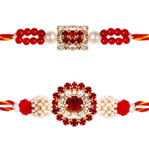 Diamond & Pearl Rakhi - Set of 2: This splendid pair of rakhis are beautifully designed with pearls, colorful beads & stones and diamond studded motifs to make these rakhis elegant and glittering. Costs Rs 458/- http://www.tajonline.com/rakhi-gifts/product/rdr56/diamond-pearl-rakhi-set-of-2/?aff=pinterest2013/