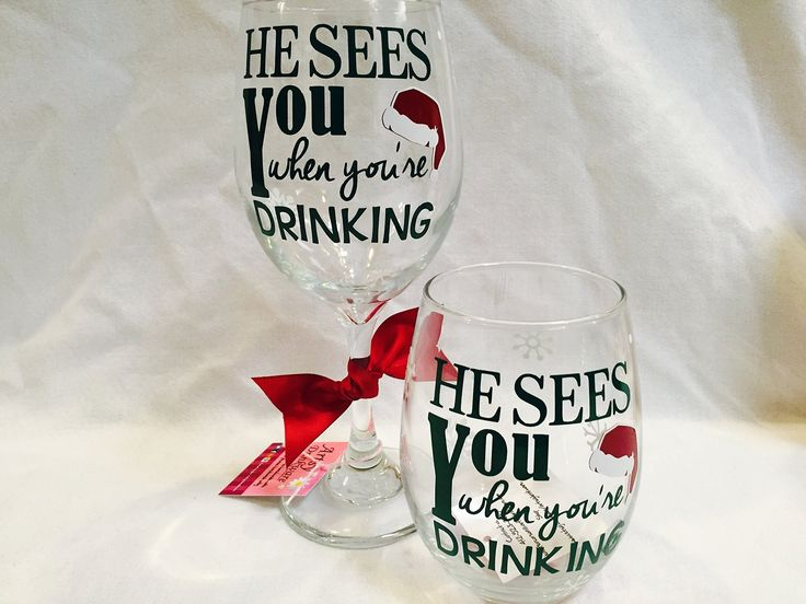 """Christmas Wine Glass, Holiday Wine Glass, He sees you when you're drinking. This glass reads """"He Sees you when you're Drinking"""" and has a santa hat are on the front of it. These make great gifts for friends, family, teachers and co-workers or any wine lover. This listing is for 1 glass and you have the option of a 21 oz stemless glass or a 20oz traditional wine glass."""