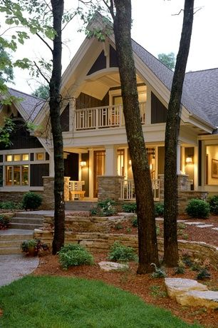 Craftsman Exterior of Home with picture window, Pathway, Paint, Flagstone garden wall, Deck Railing, Raised beds
