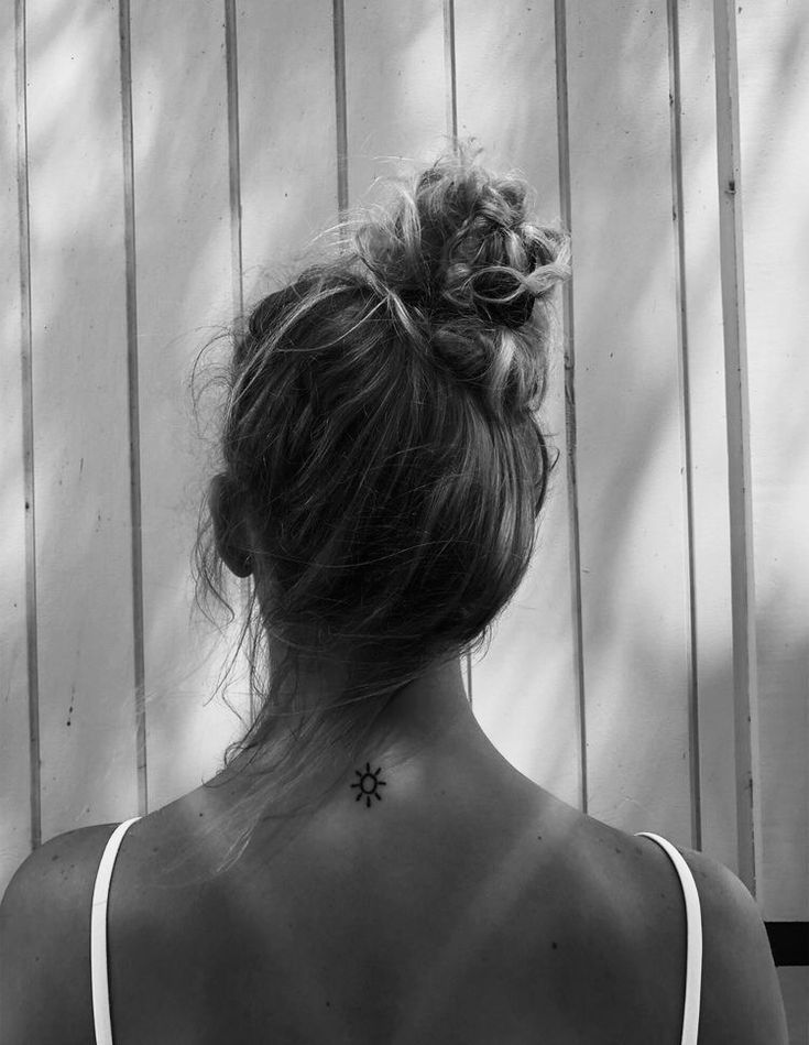 Sun Tattoo At The Back Of The Neck Top Of The Back Behind The Neck Tattoos Small Neck Tattoos Back Of Neck Tattoo