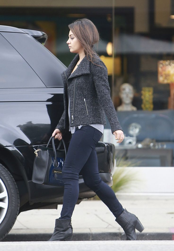 Mila Kunis Simple street style; black jeggings, black ankle boots with a thick heel, grey and black tweed moto-style jacket with a simple grey T-shirt