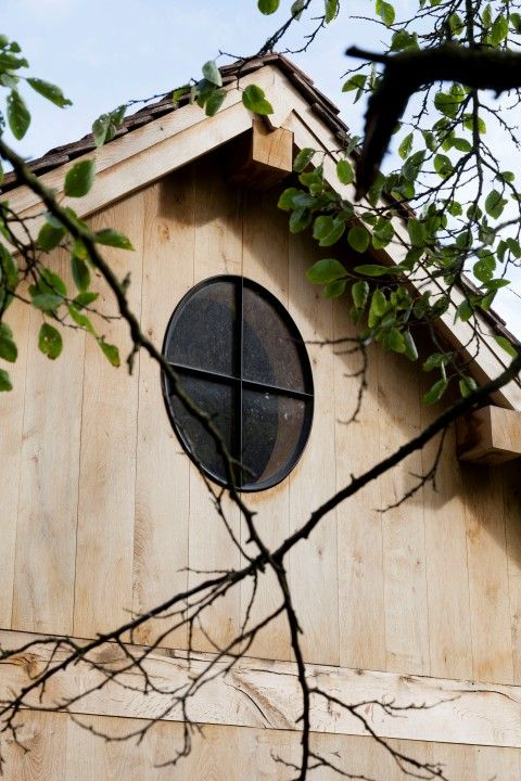 Oak Wood house black metal window poolhouse