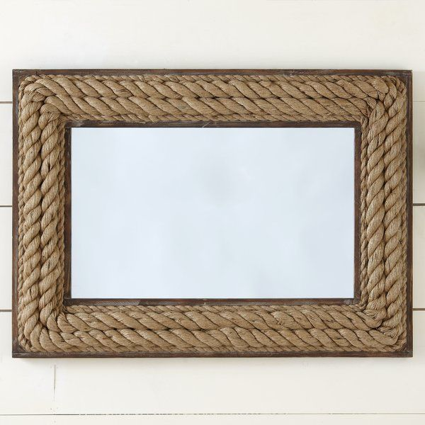 Accent your gallery wall or complement a nautical aesthetic in the entryway with this lovely mirror, featuring a rope-inspired jute frame.