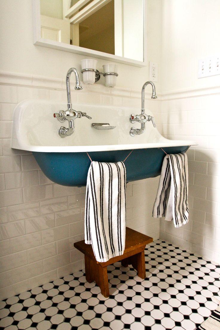 loving this blue sink - black and white tile floors