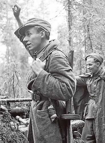 News about cease-fire between Finland and Soviets have reached frontlines and Finnish soldier is waving towards soviets lines. The Soviet Union ended hostilities exactly 24 hours after the Finns. Photo was taken in Uuksujärvi 4.9.1944