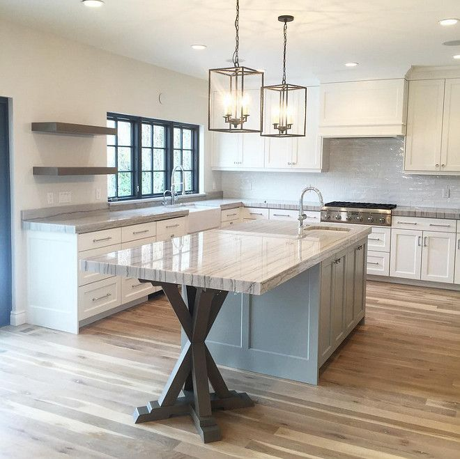 Kitchen island with trestle base...what an unique idea! CabinetsAndDesigns.net