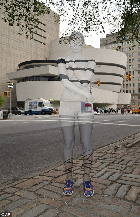 Art imitates life: New York body painter Trina Merry's models blend into the Manhattan sky...
