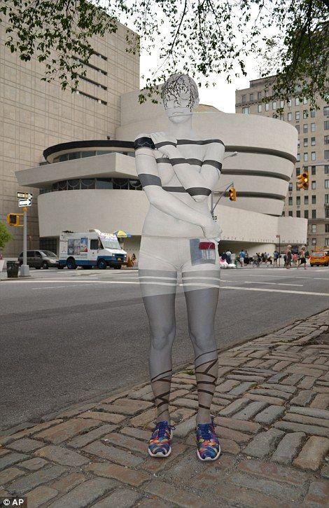 Art imitates life: New York body painter Trina Merry's models blend into the Manhattan sky...