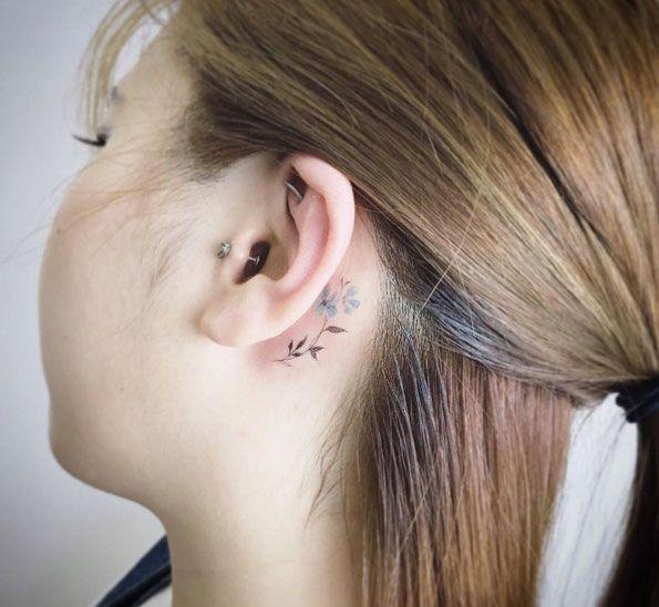 Behind-the-ear flower by Tattooist Flower