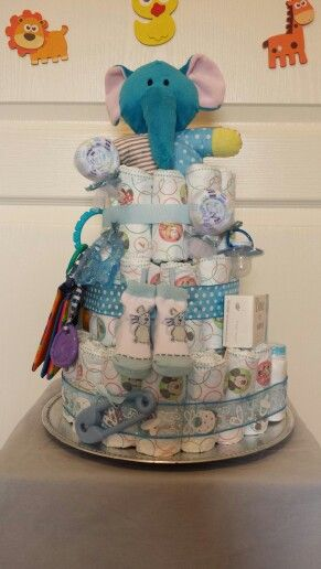 Large blue $100, elephant rattle topper,  blanket, teether, pacifier, Johnson bathing products, etc.  This diaper cake is packed full for a mom to be and her bundle of joy.